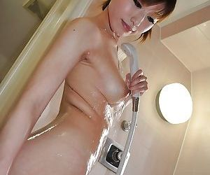 Svelte asian MILF with nice titties Kaoru Fujitani taking shower