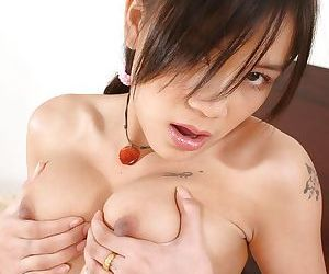 Brunette babe Gigi reveals her tight Asian pussy and big tits
