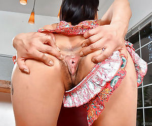 Asian amateur Saya Song tugging on hairy pussy labia lips in dining room