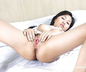 Asian babe with brunette hair reveals her hairy pussy and big tits