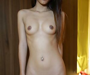 Pretty Thai local babe Jay gets nude at the hotel and shows her hairy twat
