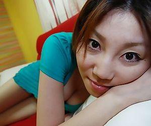 Asian teen Madoka Kanbe undressing added to exposing will not hear of shaggy twat