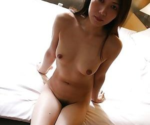 Asian brunette Hisako Kawaguchi is showing her hairy cunt on camera