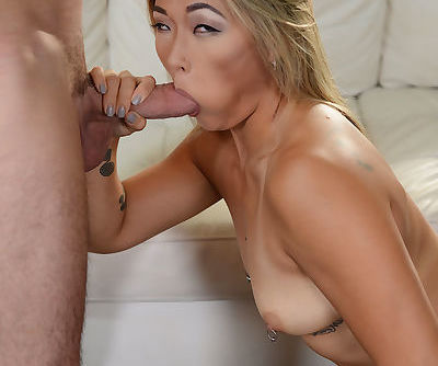 Asian pornstar Nyomi Star delivers a chipmunking blowjob on her knees