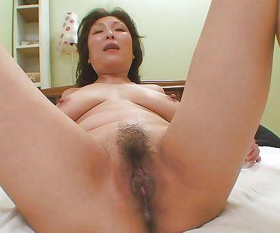Masako Suzuki masturbates her hairy cunt and gets shafted hardcore