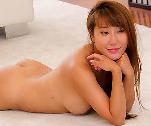 Asian female with big tits gets rid of her spandex pants before a dip
