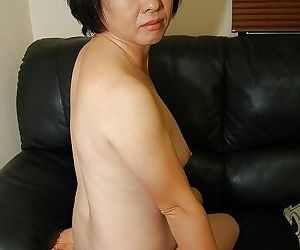 Asian mom Tomoe Nakamachi strips off skirt and spreads pink twat