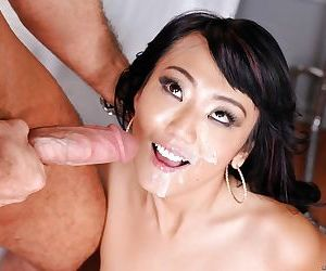 Black-haired Miko Dai is swallowing this juicy wide dong on cam