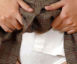 Naughty asian girl in nylon knee socks undressing and exposing her hairy cunt