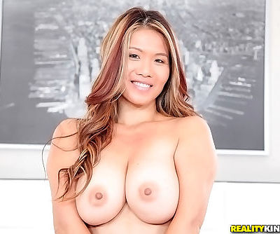 Asian milf Lucy Page shares her succulent saggy breasts with the world