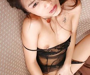 Gorgeous tiny tit Asian babe in lingerie touching herself the right way