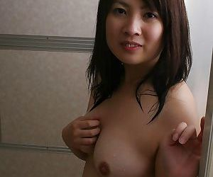 Playful asian babe with ample tits Momo Akiyama taking bath