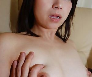 Playful asian babe strips down and has some nipples tweaking fun