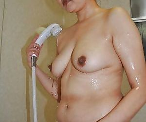 Naughty asian MILF with flabby tits Yasuko Yoshii taking shower