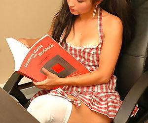 Asian schoolgirl Aria Lee exposes her big boobs attired in hooker socks