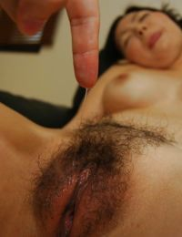 Pretty Japanese mature Ayumi Shoda fucks in her hairy snatch
