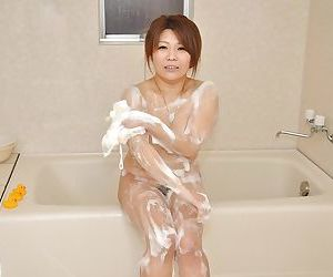 Cute asian babe Noriko washing that pussy and big ass too