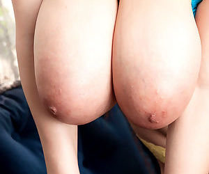 Cute Asian babe Hitomi fondles her massive saggy boobs as she strips