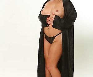 Chunky Asian female Kehlani Kalypso pulls down her black panties to model nude