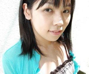Asian teen Minami Ozaki property uncovered increased by exposing her unshaven cunt