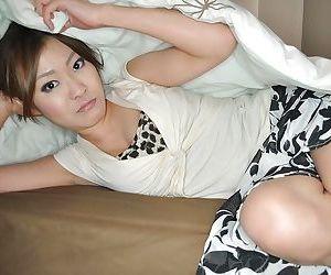 Masturbating action in close up features Asian teen babe Hitomi Aoshima