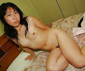 Stunning brunette babe Noriko is showing her titties and ass