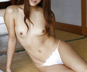 Petite Oriental model Anna Anjo posing non nude for bikini pics