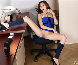 Hot secretary in glasses hiking up her skirt to flash nude pussy in the office