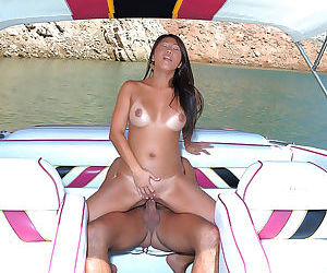 Tanned Asian girl in mini dress fucked doggystyle by huge cock on the beach