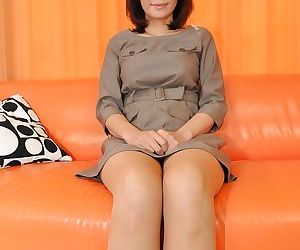 Asian MILF relative to pantyhose getting exempt from her derive coupled with toying her cunt