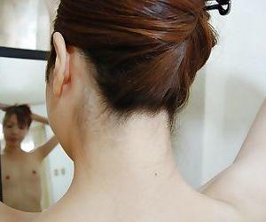 Sassy asian MILF Syoko Takaoka getting naked and toying her hairy slit