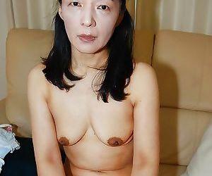 Tiny tits Asian mature Kiyoe Majima in a close up undressing scene