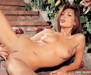 Sexy Asian MILF Tera Patrick poses naked in the Garden of Eden