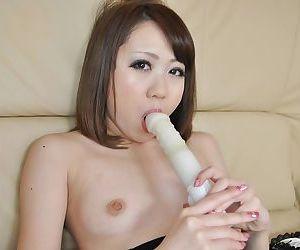 Cute brunette asian Mari undressing and masturbating her pussy