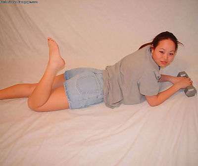 Asian teenager China is getting naked and playing with toys!