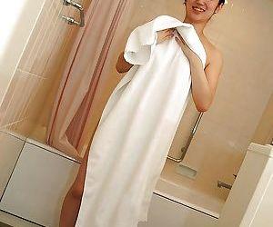 Shy asian teen with nice titties Shiori Usami taking shower