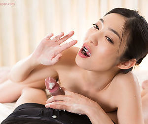 Sweet young Asian performs a stained POV handjob with an increment of licks the jizz up