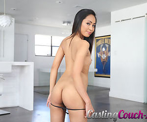Dark haired Asian girl Aurora Winters strips naked for the very first time