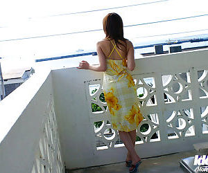 Charming asian girl Yua Aida taking stay away from say no to dress plus posing nigh lacy pantihose
