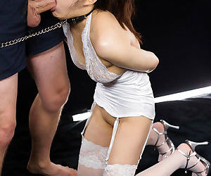 Collared Japanese chick gets mouth fucked with hands bound behind her back