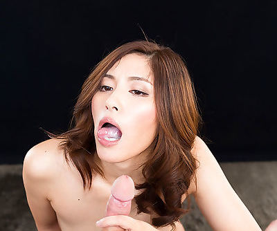 Japanese female licks and sucks a cock until it blows a load of jizz in mouth