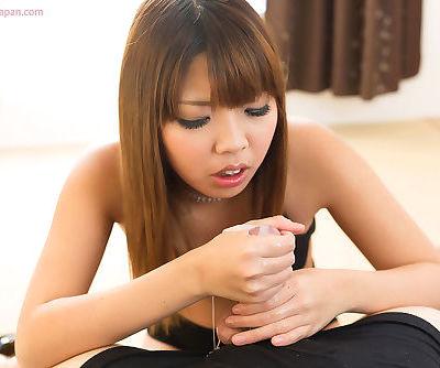 Nice Asian teen eats sperm from her fingers after giving a handjob