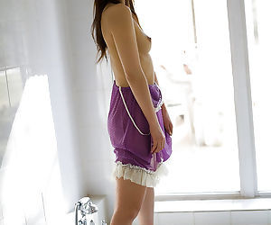 Pretty asian coed with unshaven pussy slipping off her clothes