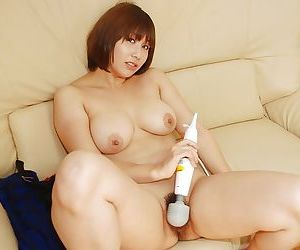 Naughty asian chick Tomoko Ochiai exposing and vibing her hairy cooter