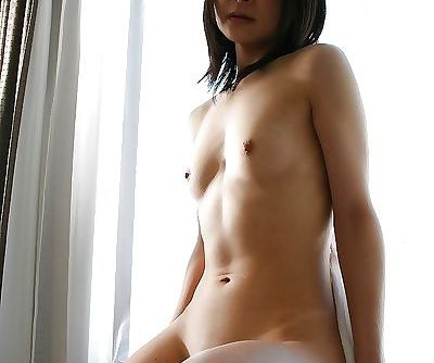 Slim asian MILF Aika Tono poses naked and showcases her bald pussy in close up
