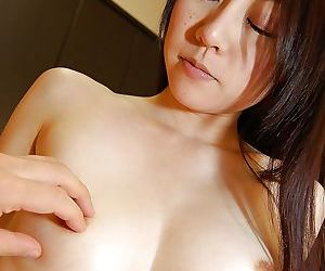 Pleasurable Asian milf with tiny tits Tomoka Horii is fingered