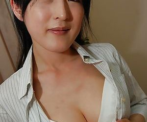 Asian lady Satomi Fujiki gets naked and enjoys pussy toying action