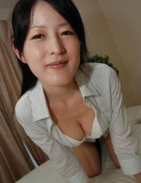 Asian lady Satomi Fujiki gets naked and enjoys pussy toying action