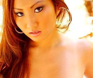 Asian redhead Jooty demonstrates her pornstar ass outdoor in black panties