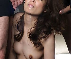 Hot oriental babe with hairy snatch on her knees to receive hot cum on face